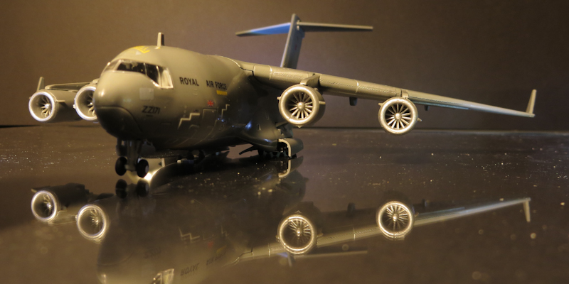 The small C17 model sits on a sheet of reflective acrylic.